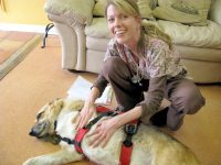 Dr. Mullins performs Reiki during dog cancer checkup